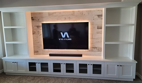 TV mount in entertainment unit with backlighting