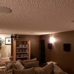 Projector hanging from ceiling with speakers