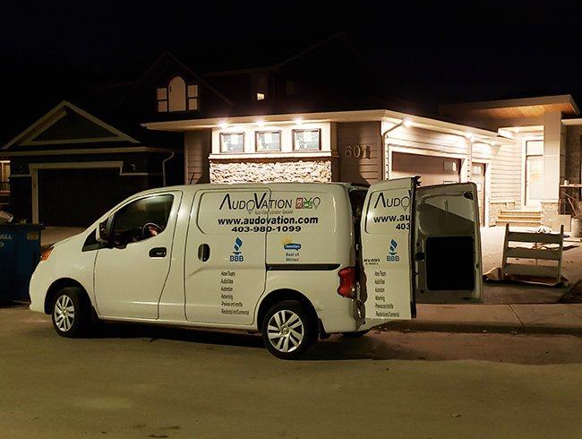 Audovation Van in front of house build