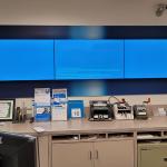 3 screen mount on office wall