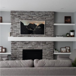 Picture frame TV mounted over fireplace