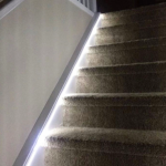 Lighting going up carpeted stairs